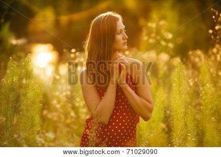 Beautiful Woman In A Dress Of Wildflowers