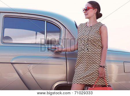 Beautiful Lady Standing Near Retro Car