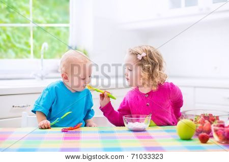 Two Children Eating Yoghurt