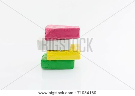 blue,white,yellow,pink color clay isolated as white background
