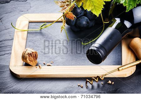 Frame With Red Wine Bottle And Fresh Grape