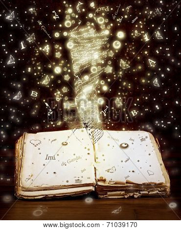 Open Book With Magic Light And Magic Letters And Drawings