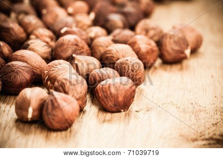 Hazelnuts On Rustic Old Wooden Table