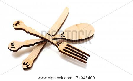 Decorative wooden utensils isolated on white