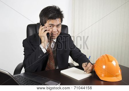 Asian Businessman Working With Labtop