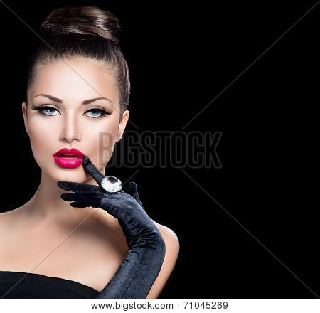 Beauty Fashion Glamour Girl Portrait over black background. Vintage Style Girl Wearing Gloves. Jewellery. Jewelry. Glamor Hairstyle and Make-up. Sexy Red Lips. Diamond Ring. Retro Woman Portrait