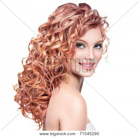 Beauty girl with red curly hair. Healthy and long permed Blonde Wavy hair. Beautiful smiling young woman portrait. Beautiful face, natural make up