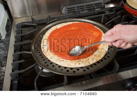 Spreading Pizza Sauce