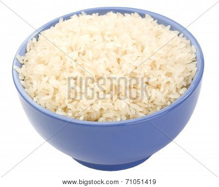 Boiled long grain rice in lilac bowl close-up isolated