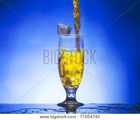 glass with  yellow liquid