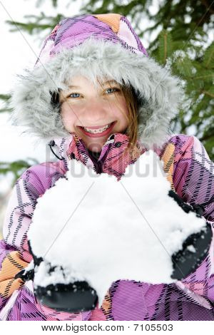 Happy Winter Girl Holding Snow