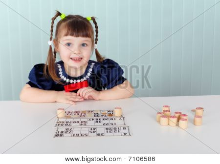 Child At Table Played With Bingo