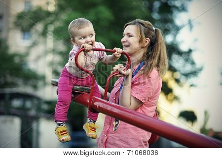 Small girl with her mother playing