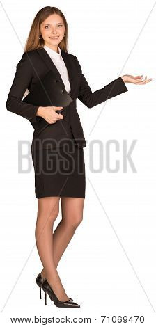 Beautiful business woman showing blank area for sign or copyspase