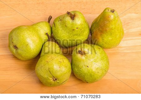 Green Bartlett Pears On Wood Table