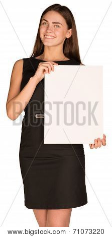 Attractive young woman holding blank paperboard