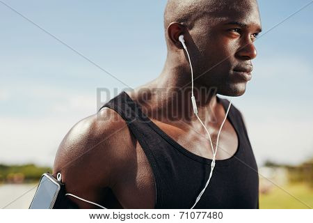 Fit Young Man Wearing Earphones