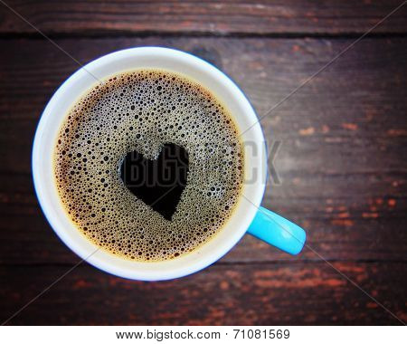 a cup of coffee with a heart shape