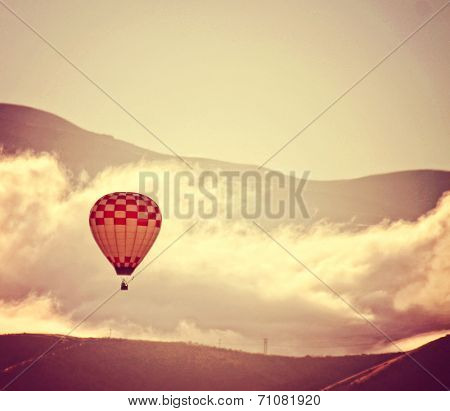a hot air balloon in the sky in front of clouds