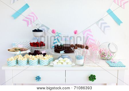 Berries, popcorn and canape selection at party table