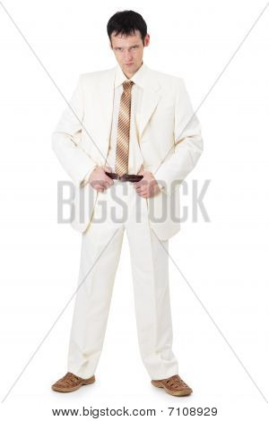 Stern Businessman In A Light Suit