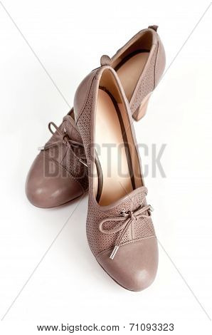 Beige Female Shoes On A Light Background