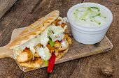 picture of gyro  - Greeg gyros with tzatziki on wood board - JPG