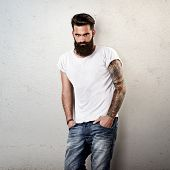 stock photo of beard  - Portrait of tattooed bearded man wearing blank t - JPG