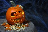 stock photo of puke  - Puking Scary Halloween pumpkin  - JPG