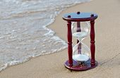 pic of sand timer  - Sand timer on the seashore in sand - JPG