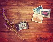 stock photo of instagram  -  Vintage photo camera on a wooden table with some snapshots and a flower toned with a retro vintage instagram filter effect  - JPG