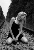 stock photo of fuck  - girl on the railway in the forest walks barefoot - JPG