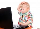 stock photo of shock awe  - Surprised Baby Boy with Laptop Isolated on the White Background - JPG