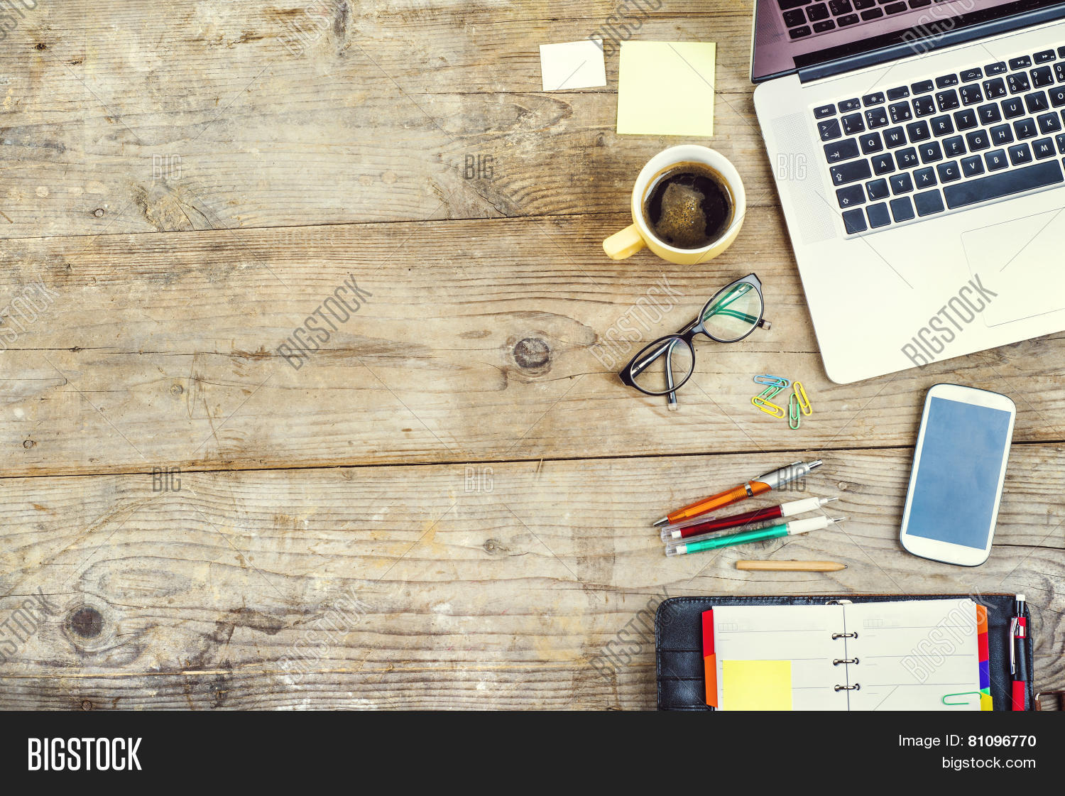 Desktop mix on a wooden office table stock photo stock for Table wallpaper