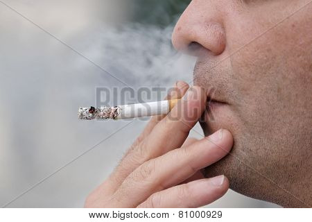 Man Face Holding Cigarette And Smoking