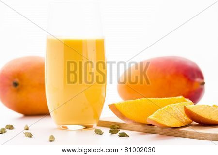 Cut Mango Pieces, Cardamon And Fruit Shake