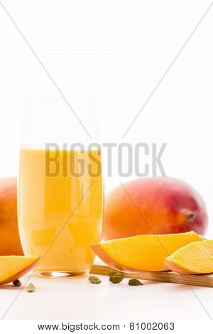 Glass Of Mango Lassi And Cut Fruit Pulp On White