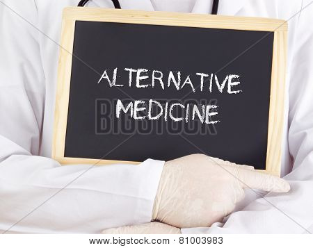 Doctor Shows Information On Blackboard: Alternative Medicine
