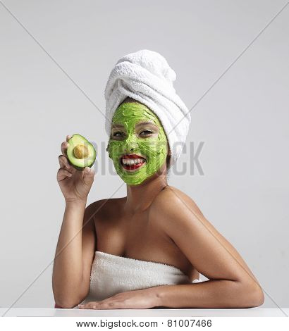 Pretty Woman With An Avocado Facial Mask