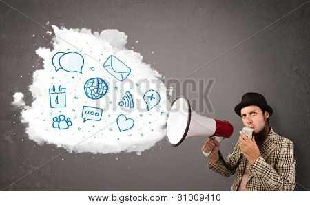 Young man shouting into loudspeaker and modern blue icons and symbols come out