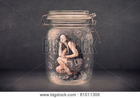 Business woman captured in glass jar with hand drawn media icons concept on background