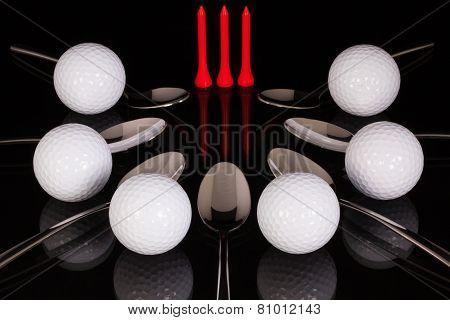 Teaspoons And Golf Equipments On The Black Glass Table