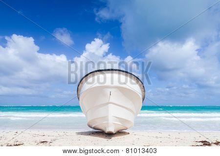 White Pleasure Boat Lays On Sandy Beach