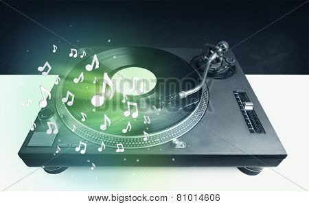 Turntable playing music with audio notes glowing concept on background