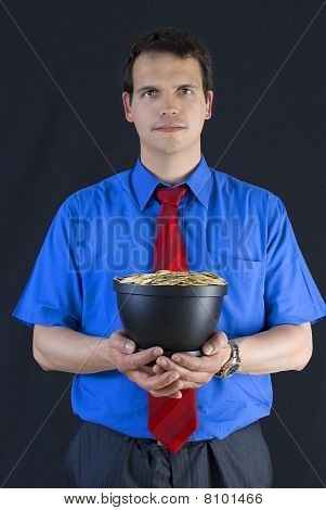 Businessman Holding A Pot With Coins.