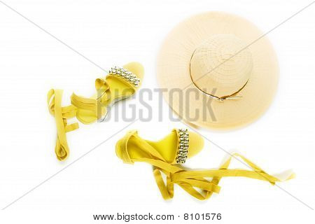 Woman shoes and a straw hat