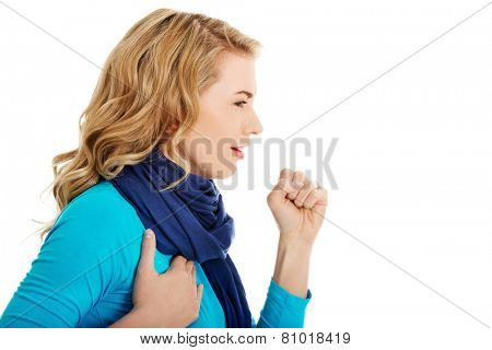 Young woman has a flu. Coughing.