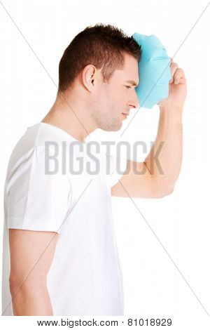 Man with ice bag for headaches, migraines ,hangover and injury