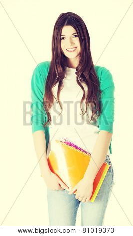 Young beautiful student woman with files, workbook.