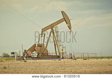 Large Pump Jack Pulling Crude Oil Up